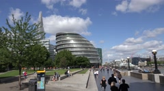 ULTRA HD 4K Tourist people enjoy Potters Fields London park City Hall building  Stock Footage