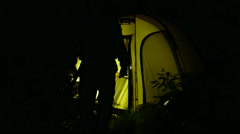 Man's tourist go in  tourist tent at night  and work at laptop. 4K 3840x2160 Stock Footage