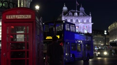 ULTRA HD 4K Traffic street Piccadilly Circus London night red telephone cabin  Stock Footage