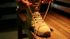 Man tying shoe laces Stock Footage