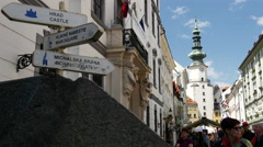 Tourist walking a front of Michael's Tower and gate in Bratislava Slovakia Stock Footage