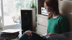 Woman putting record in gramophone Stock Footage