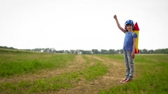 Happy kid playing in summer field - stock footage