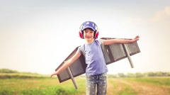Happy kid playing in summer field Stock Footage