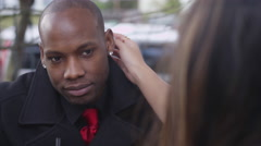 Young man talking to his date at an outdoor cafe Stock Footage