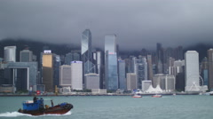 Imposing skyscrapers in Hong Kong and junk boat 4K - stock footage