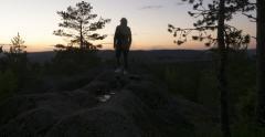 Stock Video Footage of person  campsite on mountain ignite campfire, nightfall, northern night twilight