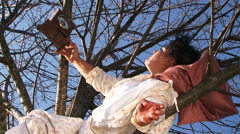 Crazy Dark-Haired Woman In Long White Nightie Laughing Lying On Tree Stock Footage