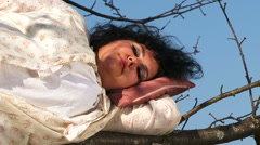 Crazy Dark-Haired Woman In Long White Nightie Sleeping On Tree Stock Footage