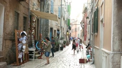 Tourists walking in street of Rovinj - stock footage