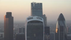 4K Aerial view London skyscraper Gherkin business tower central British sunset  - stock footage