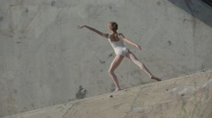 Video footage of the young graceful ballerina who dances - stock footage