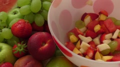 Healthy fruit salad in the glass bowl Stock Footage