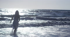 Beautiful Mexican woman walking to shore Stock Footage
