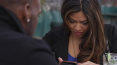 A woman reads a text on her phone while on a date Stock Footage