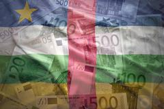 colorful waving central african republic flag on a euro money background - stock photo