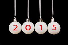 Four white christmas balls with year 2015 Stock Photos