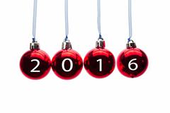 Hanging red christmas balls with numbers of year 2016 Stock Photos