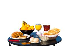 Table with food as breakfast on white background Stock Photos