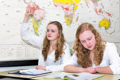 Dutch teenage girl with learn finger in geography lesson Stock Photos