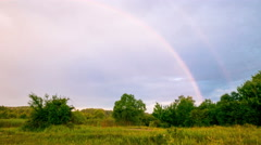 Landscape with beautiful sky  and disappearing rainbow . 4K 4096x2304 Time laps Stock Footage