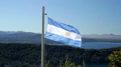 Argentina flag waving in Nahuel Huapi National Park Stock Footage