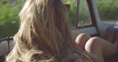 Young wild free woman in convertible car on a road trip in the wind slow motion Stock Footage