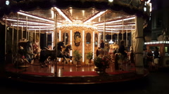 Old carousel turning around in the evening Stock Footage