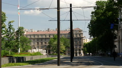 Yellow tram passing by the The Hungarian Parliament Building in Budapest Stock Footage