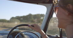 beautiful girl driving vintage car on road trip - stock footage