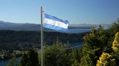 Argentina flag waving in Nahuel Huapi National Park Stock Footage