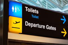 Airport sign for toilet and departure gates Stock Photos