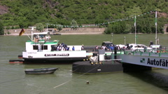 Car ferry approaching jetty on Rhine river in Boppard Stock Footage