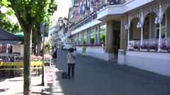 Street in Boppard with flags outside building Stock Footage