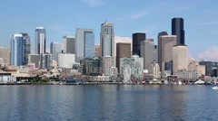 Boat passing in front of the Seattle waterfront Stock Footage