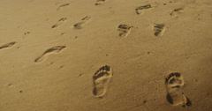 Closeup of footprints in the sand Stock Footage