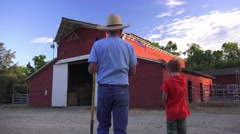 Farm rancher and flag waving grandson Stock Footage