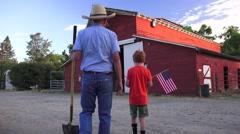 Stock Video Footage of Farm rancher walking the barnyard