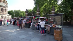 Unidentified tourists walk by souvenirs stalls Stock Footage