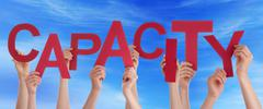 Many People Hands Hold Red Word Capacity Blue Sky - stock photo