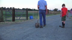 Farm rancher, kicking can on dirt road Stock Footage