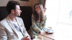 Flirting couple in cafe - stock footage