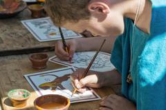 Boy paints antique picture Stock Photos