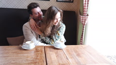 Flirting  couple speak in cafe - stock footage