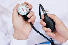 Blood Pressure Gage In a Doctor's Hands - stock photo