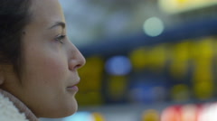 4k, Close up of tired female waiting for a train at the end of her working day Stock Footage
