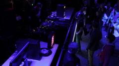 DJ performing at nightclub, public enjoying good music, dancing Stock Footage