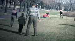 NEW HAVEN, CONNECTICUT - 1958: Family enjoying some football during the Stock Footage