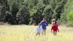 Family On Hike In Beautiful Countryside Stock Footage