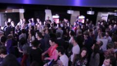 DJ set at nightclub, public enjoying music, dancing, clubbing Stock Footage